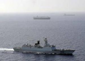 Крейсер `Петр Великий` провел досмотровую операцию в Индийском океане