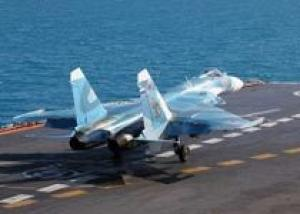 Летчик-истребитель Юрий Суслов совершил сотую посадку на палубу крейсера `Адмирал Кузнецов`
