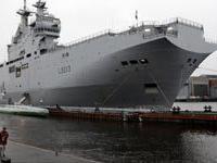 Контракт с РФ по `Мистралям` выполняется без изменений и будет завершен в октябре, заверил президент Франции
